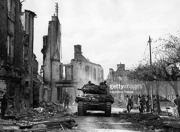 An American Tank On Its Way To Brest Crossing The Commune Of Lambezellec Devastated By Allied Bombings In The Outskirts In JulyAugust 1944