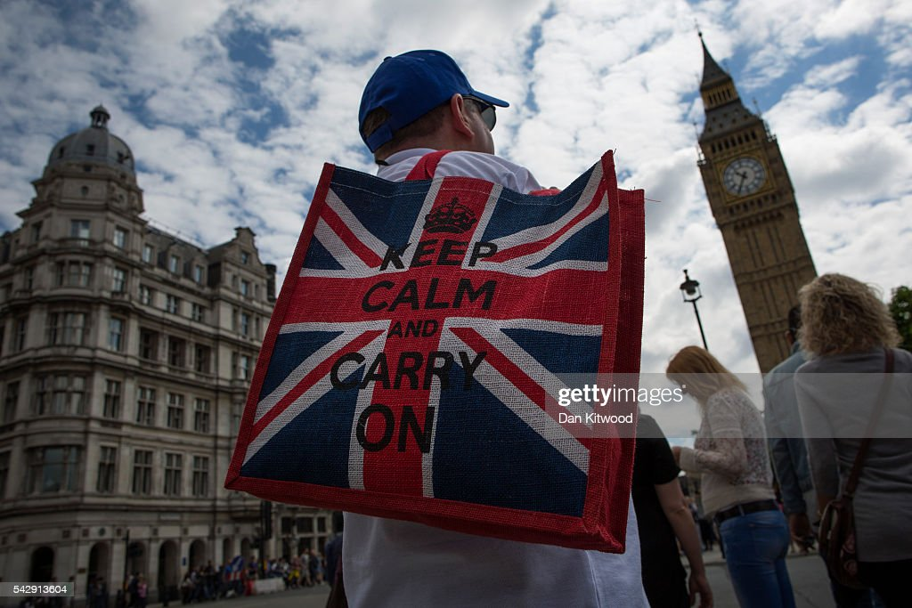 An American tourist stands near the Houses of Parliament the day after the majority of the British public voted to leave the European Union on June 25, 2016 in London, England. The weakening of the pound against other currencies could mean good news for foreigners wishing to travel to the UK. The ramifications of the historic referendum yesterday that saw the United Kingdom vote to Leave the European Union are still being fully understood. The Labour leader, Jeremy Corbyn, who is under pressure from within his party to resign has blamed the 'Brexit' vote on 'powerlessness', 'austerity' and peoples fears over the issue of immigration.