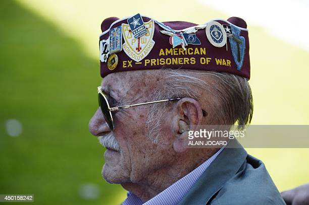 An american veteran attends a joint FrenchUS DDay commemoration ceremony at the Normandy American Cemetery and Memorial in Collevillesurmer Normandy...