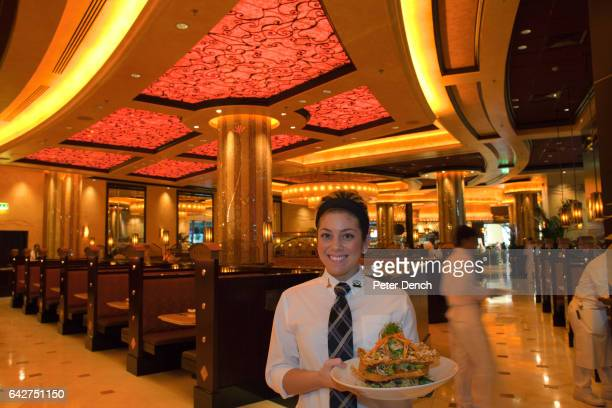 An American waitress in Dubai to teach new recruits with a Luau Salad The Cheesecake Factory in the Mall of the Emirates is the US chain's largest...