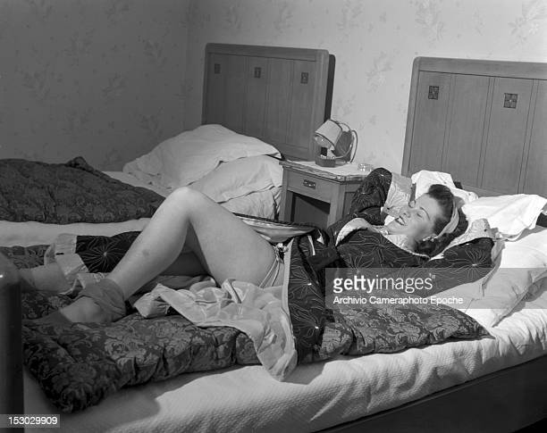 An American young woman lying up in bed Lausanne 4th January 1949