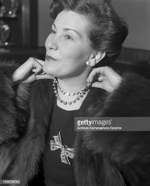 An American young woman wearing a fur portrayed while trying on a necklace in Lausanne 4th January 1949