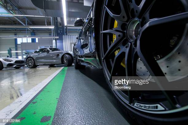 An AMG marque badge sits on the alloy wheel rim of a newly assembled MercedesBenz AG AMG GT high performance luxury automobile during final checks at...