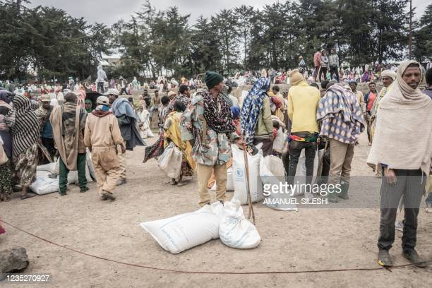 An Amhara militiaman looks on during a food distribution of wheat by the World Food Programme for internally displaced people in Debark, 90...