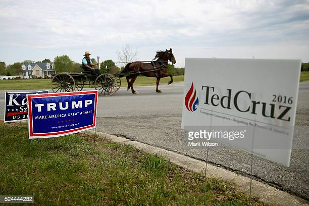 An Amish buggy travels past the White Marsh Elementary School which today is serving as a polling station April 26 2016 in Mechanicsville Maryland...