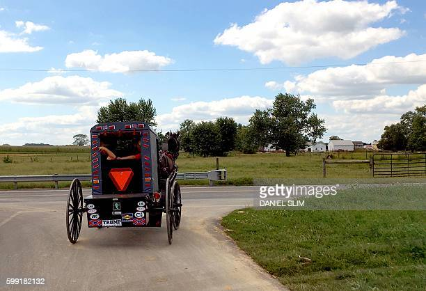 An Amish buggy with a sticker in support of Republican US presidential nominee Donald Trump drives down a road in rural Lancaster Pennsylvania / AFP...
