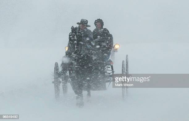 An Amish couple rides in a horse drawn open buggy through a blizzard on February 10 2010 in St Mary's Md The St Mary's is being hit with a second...