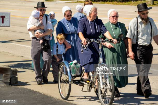 An Amish family walking in Mennonite