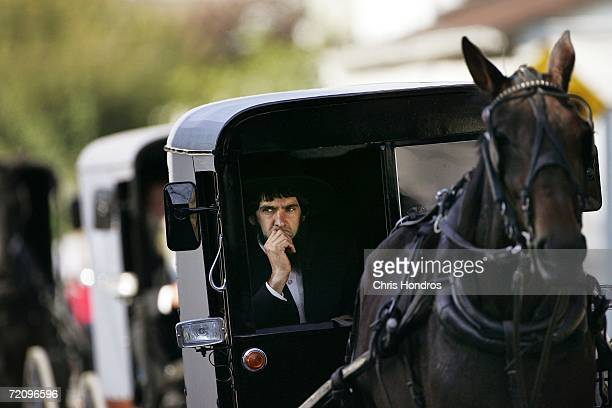 An Amish man drives a horsedrawn carriage during the funeral processionl for a slain Amish schoolgirl October 5 2006 in Bart Township Pennsylvania...