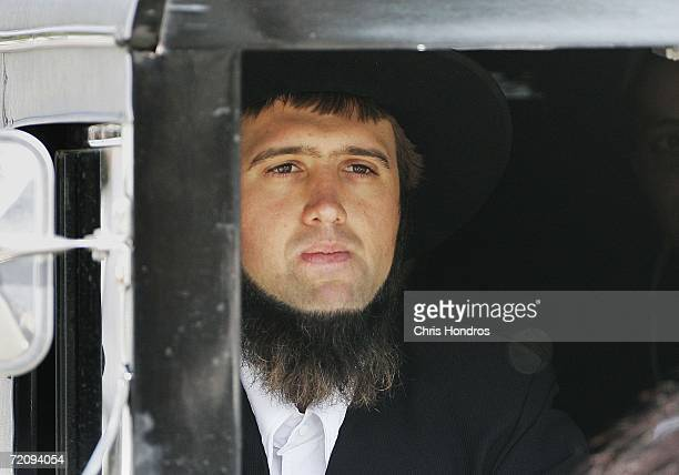 An Amish man drives a horsedrawn carriage during the funeral procession of slain Amish schoolgirl Naomi Rose Ebersole October 5 2006 in Bart Township...