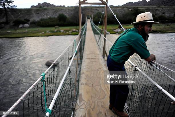 An Amish man who was camping with his family on vacation from Missouri who didn't want to give his name stands on a bridge that crosses the river at...