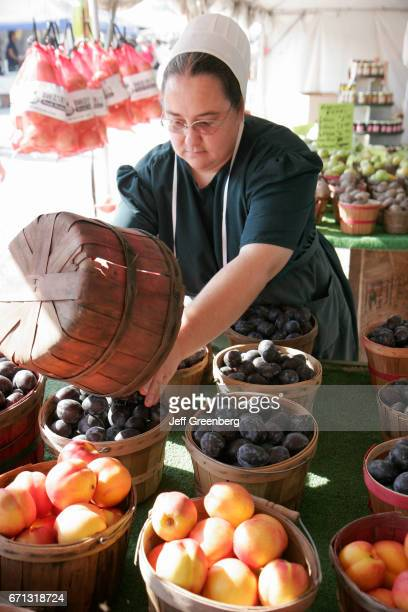 An Amish woman filling fruit baskets at Shipshewana Flea Market