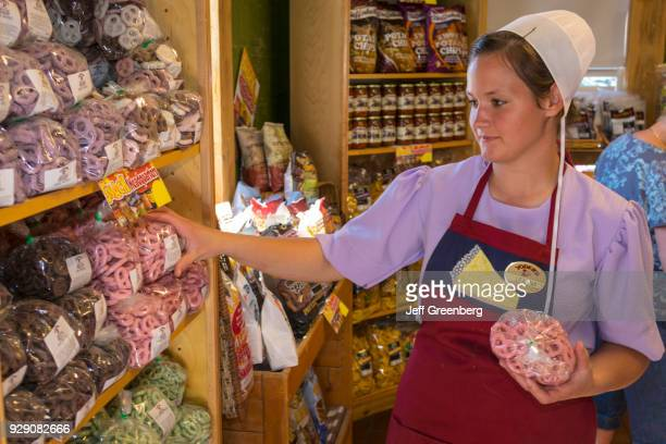An Amish woman stocking shelves in the Yoder's Amish Village gift shop