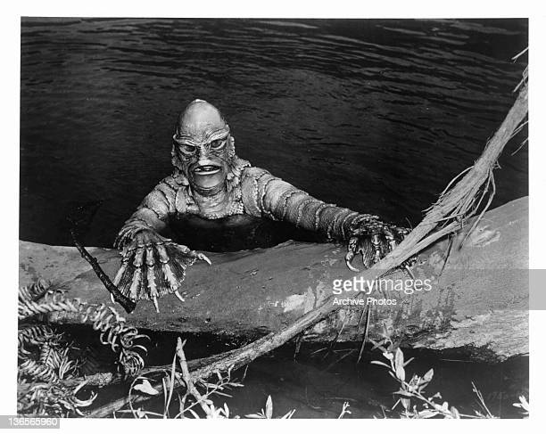 An amphibian-like monster coming out of the lagoon in a scene from the film 'Creature From The Black Lagoon', 1954.