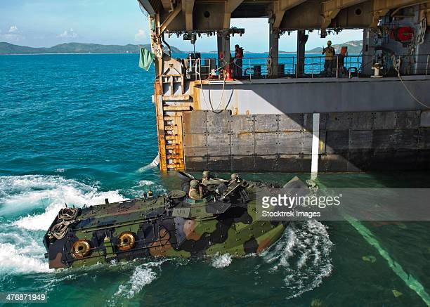 An amphibious assault vehicle enters the well deck of USS Tortuga.