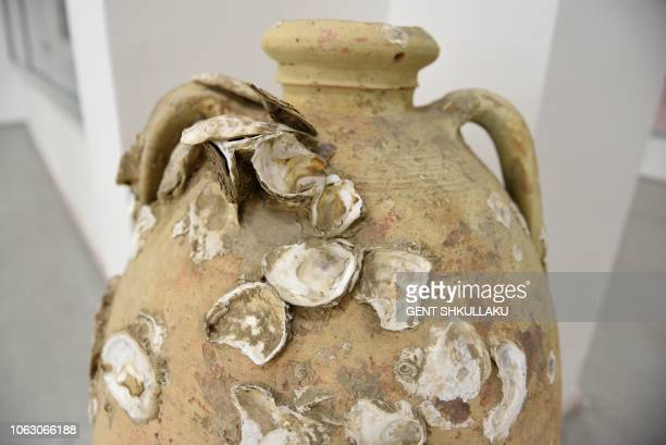 An amphora from the 4th century BC and found underwater in Butrint is displayed at Albania's National Archeological Museum in Tirana on September 24...