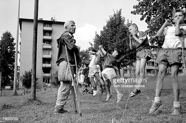 An amputee football coach who was wounded by a shell coaches young players after the war ended During the 47 months between the spring of 1992 and...