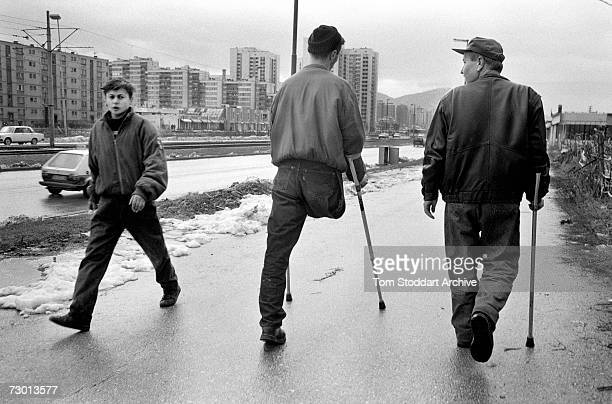 An amputee on crutches walks along the main road known as Sniper Alley. During the 47 months between the spring of 1992 and February 1996, the people...