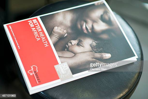 An AMREF brochure lies during a shoot for AMREF in Salon Shan Rahimkhan on a chair on December 16 2013 in Berlin Germany