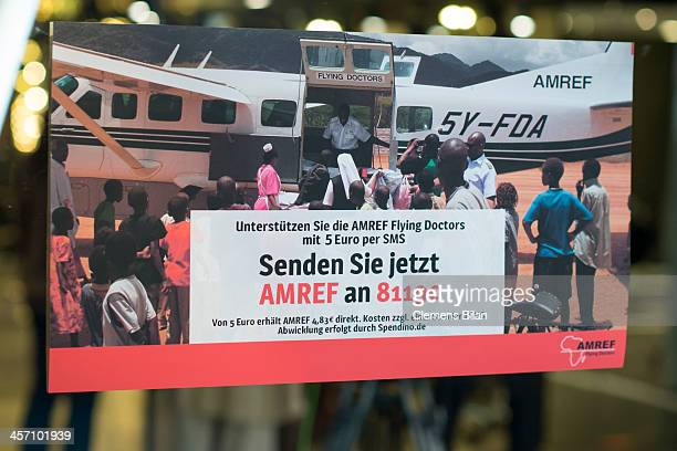 An AMREF poster hangs during a shoot for AMREF in Salon Shan Rahimkhan on a mirror on December 16 2013 in Berlin Germany