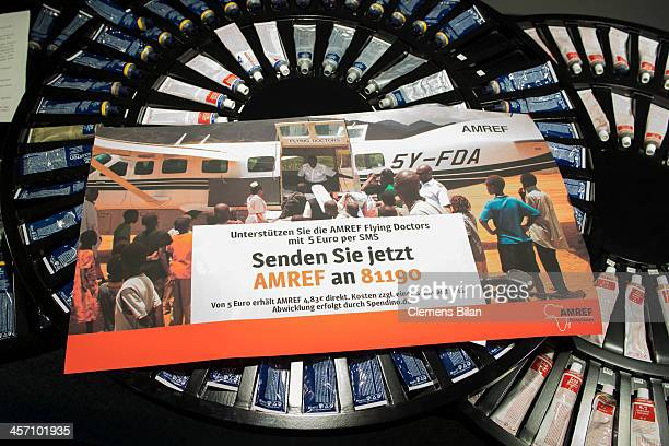 An AMREF poster lies during a shoot for AMREF in Salon Shan Rahimkhan on a desk on December 16 2013 in Berlin Germany