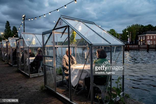 An Amsterdam restaurant uses greenhouses as protection against coronavirus for their guests on May 12 2020 in Amsterdam the Netherlands