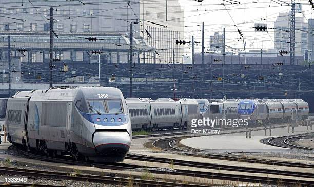 An Amtrak Acela Express train sits in the 30th Street Station August 13 2002 in Philadelphia Pennsylvania Amtrak has suspended Acela Express train...