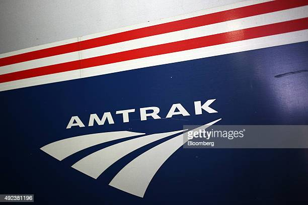 An Amtrak logo is seen on the side of a passenger train on the platform at Union Station in Chicago Illinois US on Thursday Oct 8 2015 The head of...