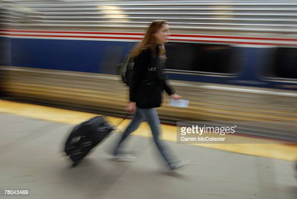 An Amtrak passenger hurries to board her train November 21 2007 at South Station in Boston Massachusetts A record thirtyeight million people were...