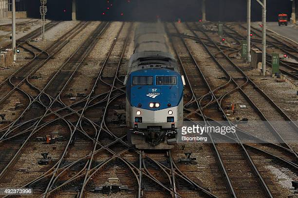 An Amtrak passenger train navigates switches while departing from the south end of Union Station in Chicago Illinois US on Wednesday Oct 7 2015 The...