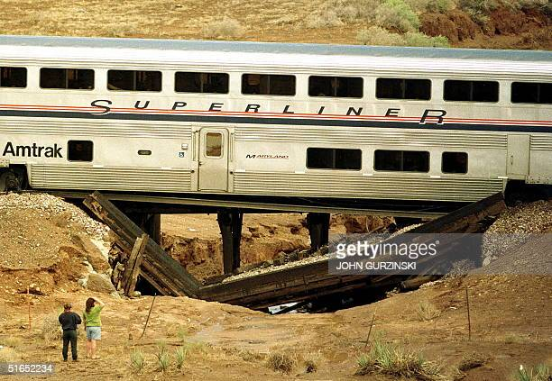 An Amtrak passenger train rests atop a railroad tressel that broke during a storm and caused an early morning derailment 13 miles East of Kingman...