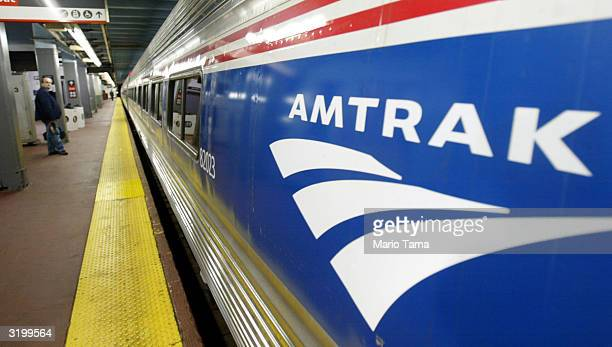 An Amtrak passenger waits for his train at Penn Station April 2 2004 in New York City Security officials have received recent threats regarding the...