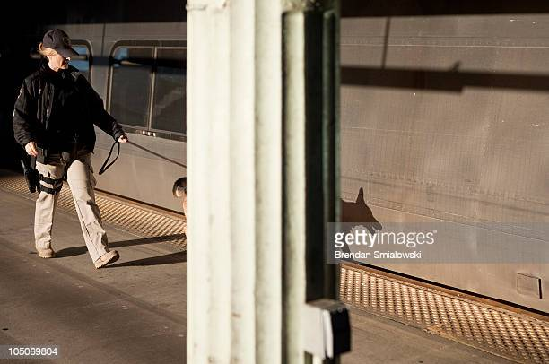An Amtrak Police Officer and her K9 patrol the platform near the Acela Express trains during 'Operation Railsafe' at Union Station October 8 2010 in...