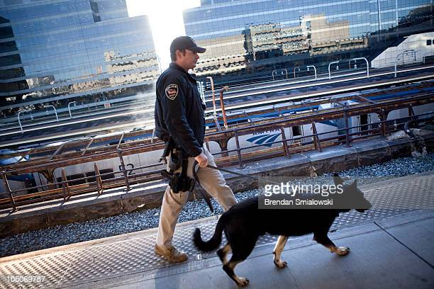 An Amtrak Police Officer and his K9 patrol the platform during 'Operation Railsafe' at Union Station October 8 2010 in Washington DC Amtrak the...