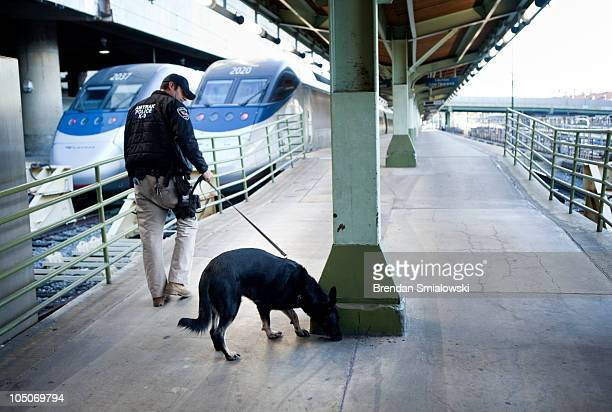 An Amtrak Police Officer and his K9 patrol the platform near the Acela Express trains during 'Operation Railsafe' at Union Station October 8 2010 in...