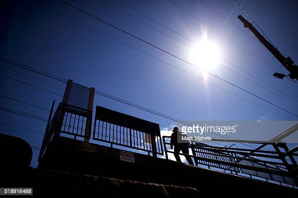 An Amtrak police officer monitors activity at the Highland Avenue train station near the crash site of Amtrak Palmetto train 89 on April 3 2016 in...