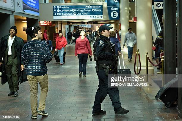 An Amtrak Police officer patrols Union Station March 22 2016 in Washington DC New York and Washington stepped up security in the wake of the attacks...