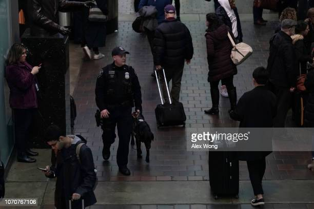 An Amtrak Police officer patrols with his canine at Union Station on the day before the Thanksgiving holiday November 21 2018 in Washington DC...