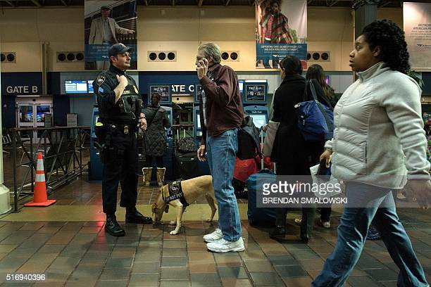 An Amtrak Police officer speaks with a traveler at Union Station March 22 2016 in Washington DC New York and Washington stepped up security in the...