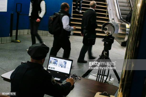 An Amtrak Police officer works with the new devices designed to detect explosives at New York City's Penn Station on February 27 2018 in New York...