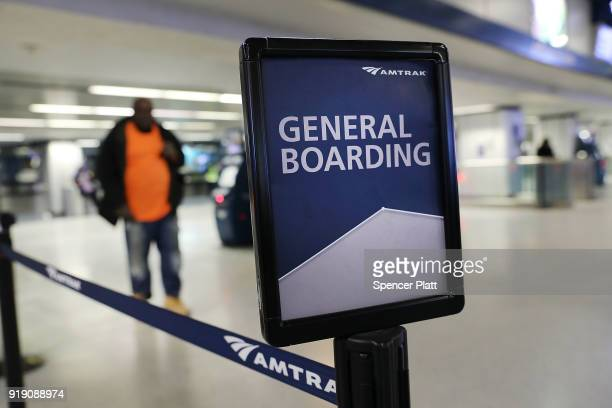 An Amtrak sign directs passengers at New York's Pennsylvania Station on February 16 2018 in New York City Amtrak gave a media tour on Friday to show...