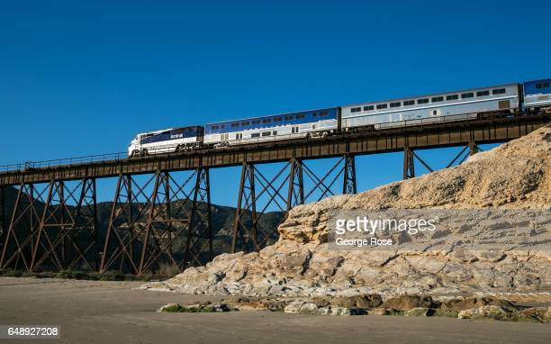 An Amtrak Surfliner train passes over the steel trestle at Gaviota Beach on December 28 in Gaviota State Park California Because of its close...