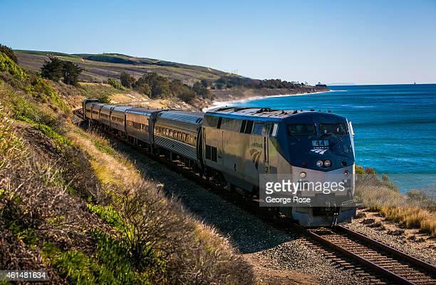An Amtrak 'Surfrider' train runs along the coast near El Capitan State Beach on December 24 in Santa Barbara California Because of its close...
