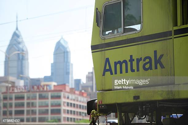 An Amtrak train is parked with a view of the skyline near 30th Street Station which resumed northbound service with a 553am departing train after...