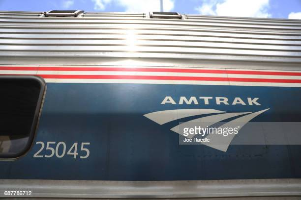 An Amtrak train is seen as people board at the Miami station on May 24 2017 in Miami Florida President Donald Trump's budget proposal would terminate...