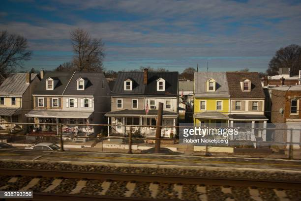 An Amtrak train moves past newly constructed homes January 13 2018 north of Wilmington Delaware