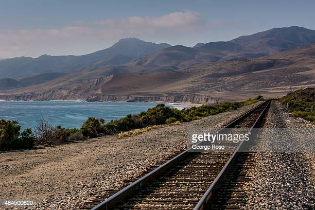 An Amtrak train track hugs the rugged California coastline as viewed on August 9 in Jalama Beach California Because of its close proximity to...
