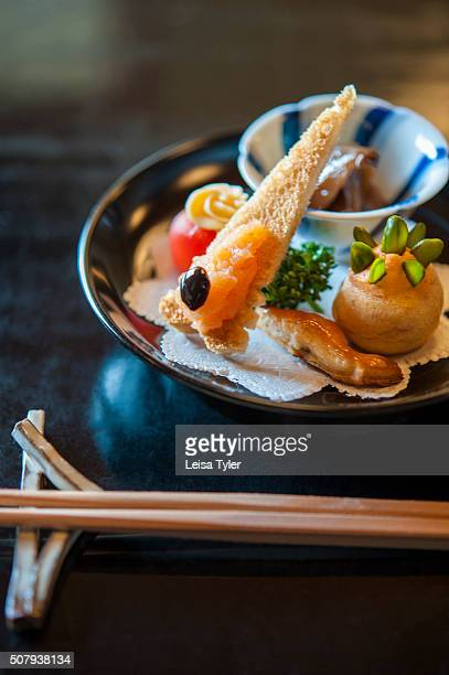 An amusebouche at Misoguigawa a restaurant in Kyoto where influenced by the Belle Epoque era in Frances history chef Teruo Inoue has taken the...