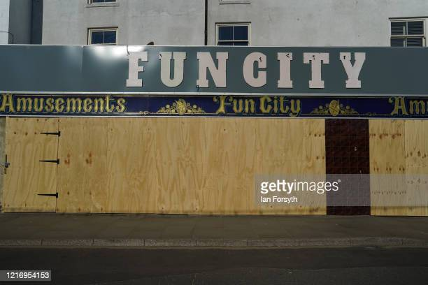 An amusement arcade is boarded up in Whitby as visitors observe the guidelines and stay at home during the Coronavirus pandemic lockdown on April 05,...