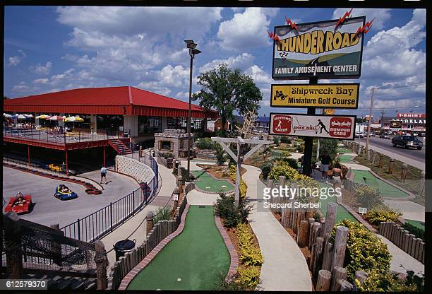 An amusement center in Branson Missouri offers fun for visiting tourists With over 30 theaters performing live shows daily Branson draws music fans...